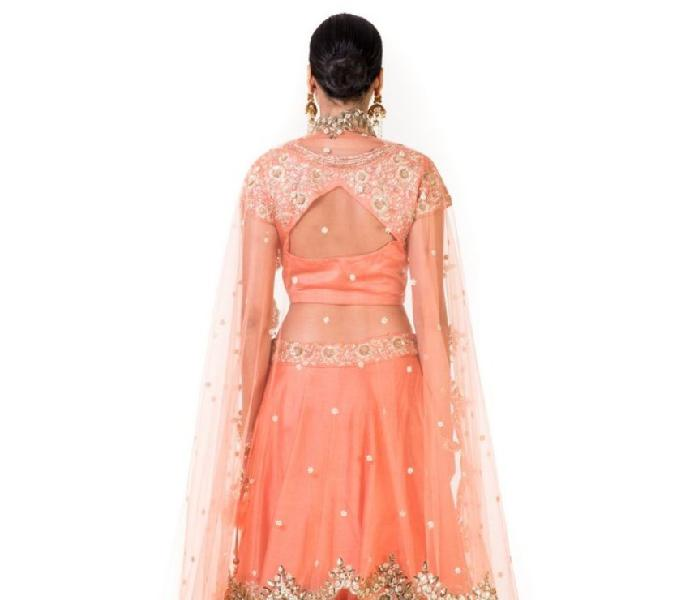 Peach hand embroidered bridal lehenga with a heavily embroid