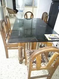 Glass top teak wooden dining table