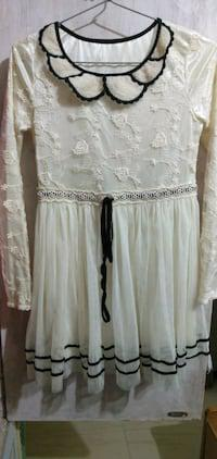 Embroidered white knee length dress.