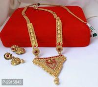 Traditional stone studded golden alloy jewellery set