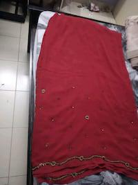 Pinkish red color designer saree with beads work