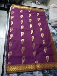 Unused semi silk saree with blouse siz 32