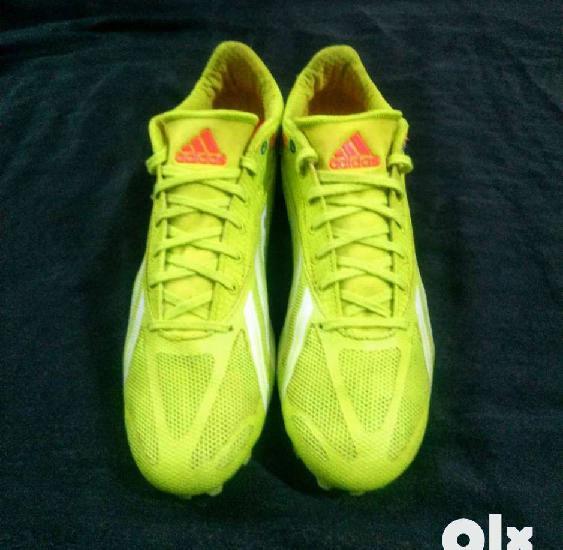 Adidas sprint star running spike shoe.