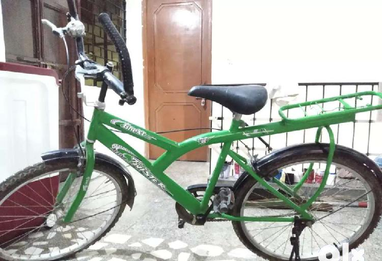 Green new bicycle for sale