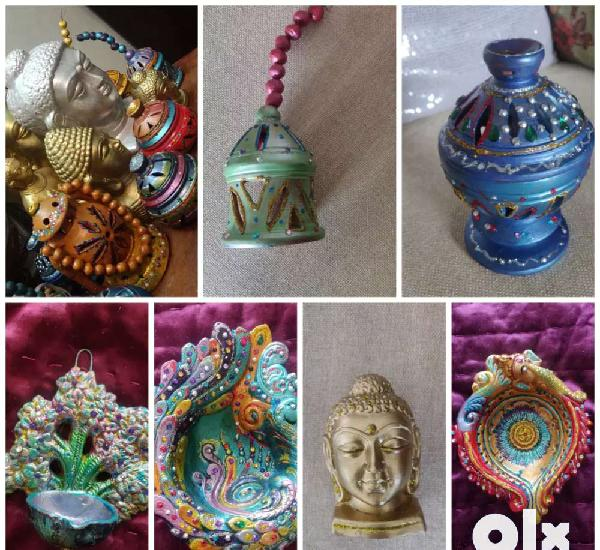 Eco friendly, earthen buddhas,lamps,big and small diyas for