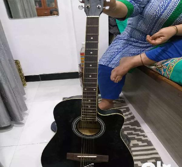 6 year old jimm acoustic black guitar