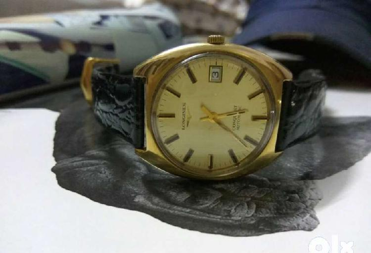 Black leather strap gold automatic longines vintage watch