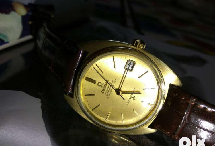 Black leather strap gold stubbed round omega automatic watch
