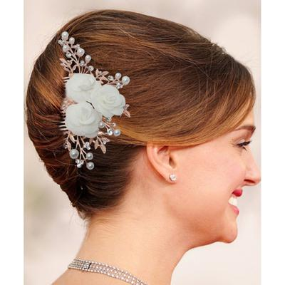 Rose gold hair brooch with pearl and floral design at