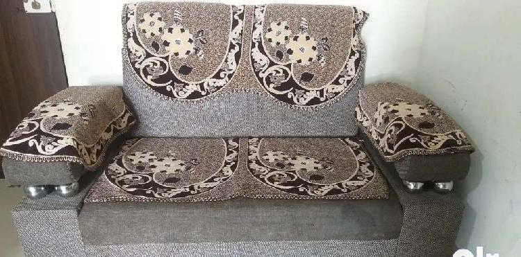 2 seater sofa with sofa covers in good condition available