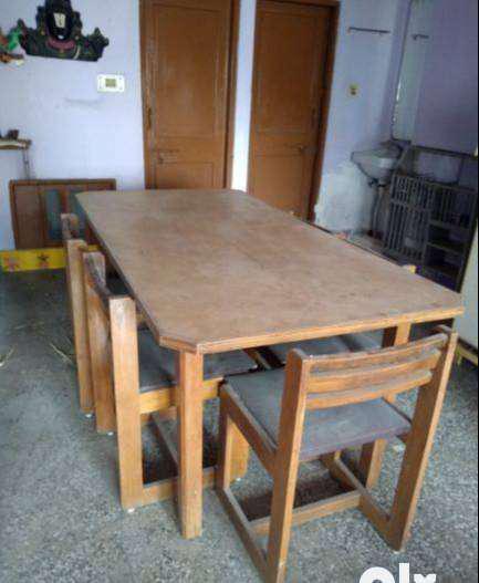 A set of teak wood six seater dinning table with six teak