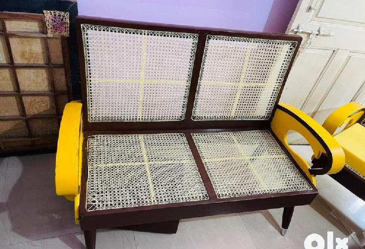 Wooden sofa with plastic cane/wire seat & back