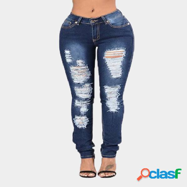 Dark blue middle-waist skinny shredded ripped jeans with four pockets